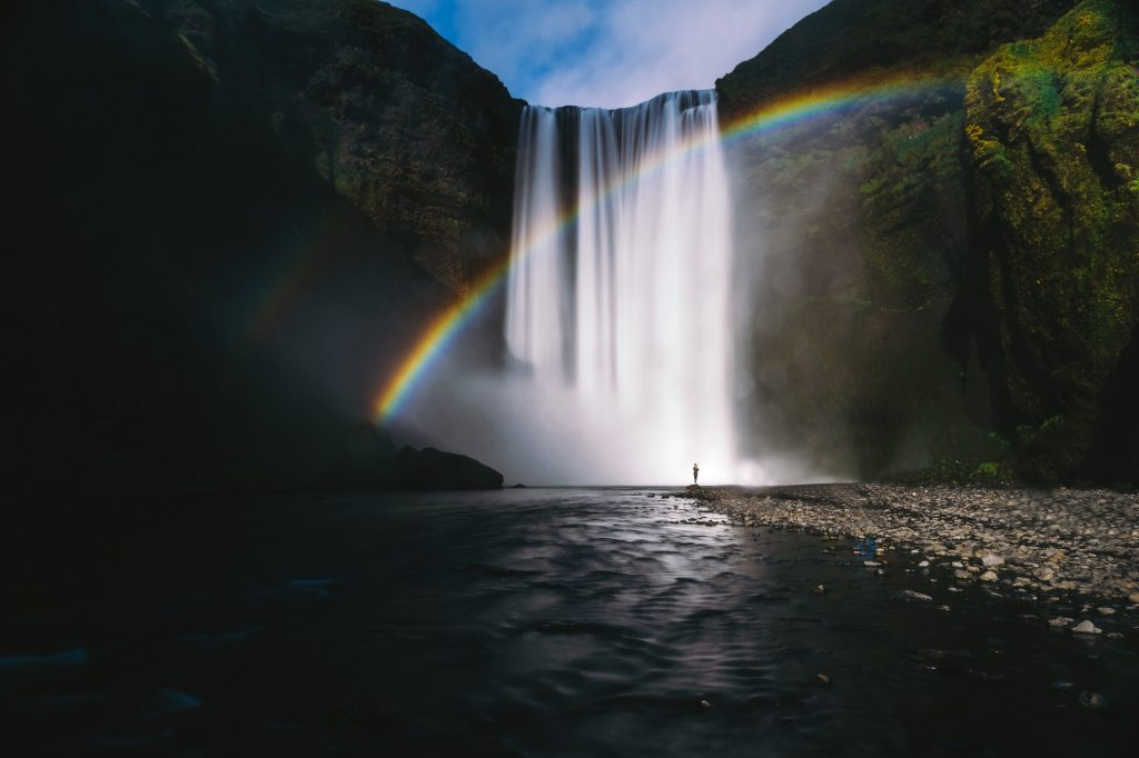 rainbow over a waterfall